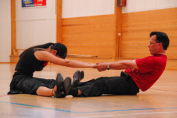 Johanna and Frans stretching during training.