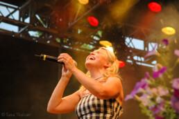Maarit Taavitsainen, winner of the tango singing contest in 1995, performing on stage.